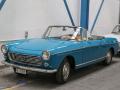 Peugeot 404 Cabriolet. Hier ein frühes Modell mit den runden Blinkern/Standlichtern